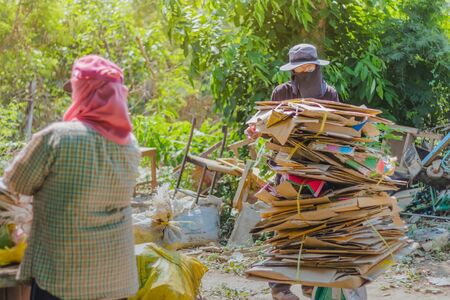KANCHANABURI, THAILAND - FEBRUARY 13 2018: Unidentified Junk buyers are sorting waste that is not used for proper recycling at school on february 13, 2018 in Kanchanaburi, Thailand