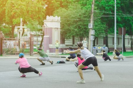 Group of elderly friend doing aerobic dance after work   together at Lumpini Park in Bangkok, Thailand. Stock Photo
