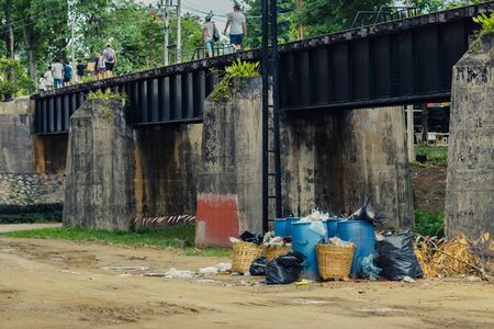 The area that dumped garbage under The Bridge of the River Kwai in Kanchanaburi, Thailand. pollution garbage waste, lots of junk dump, plastic garbage waste is environment pollution.