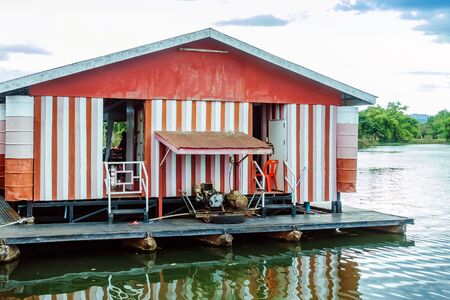 The old electricity generator for floating wooden raft house by using towing boat.