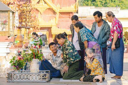 BAGAN-Myanmar, January 21, 2019 : Unidentified tourists make merit and photographing at Shwezigon Pagoda on january 21,2019 in Bagan, Myanmar.