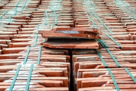 Close up to many pile of roof tiles traditional clay stack for a Buddhist Temple restoration in vintage style in Thailand. Stock fotó - 134743018
