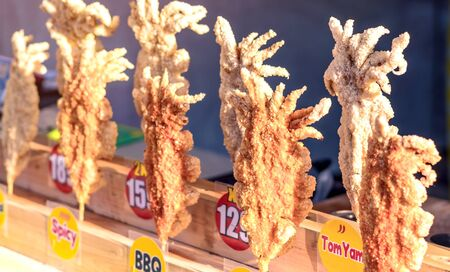 Large fried Japanese squid fried on skewers for sale in street food in Thailand. Фото со стока