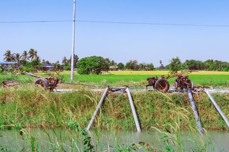 Row of water pump on trailer used to pump water from irrigation canal to enter agricultural areas Stock fotó