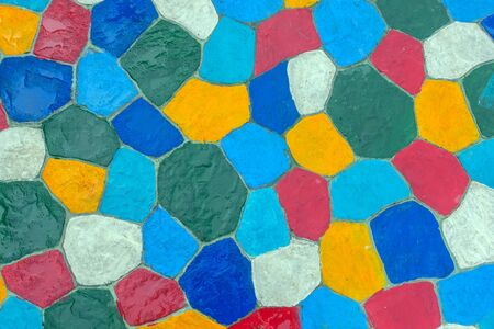 The walkway in the garden are paved with brightly colored stones and have just been cleaned by washing with water.