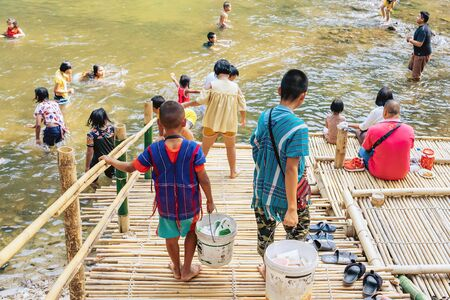 RATCHABURI THAILAND-JANUARY 19,2020 : Unidentified people come to visit, relax and swim in the stream at Ohpoi Market on january 19, 2020 in Ratchaburi Thailand.