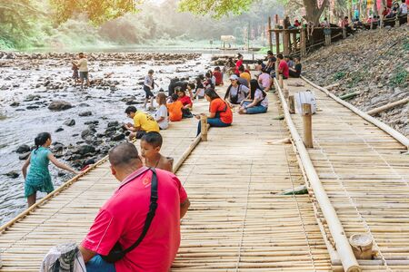 RATCHABURI THAILAND-JANUARY 19, 2020 : Unidentified people come to visit, relax and swim in the stream at Ohpoi Market on january 19, 2020 in Ratchaburi Thailand.