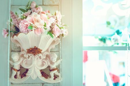 Many artificial pink and white roses are decorated on the wall to the backdrop in the wedding day. Beautiful flowers background, Selective focus. 版權商用圖片