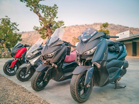 KANCHANABURI, THAILAND - JANUARY 12, 2020 : Yamaha X-Max gang were parking in the line for meeting and gathering after touring together at the gas station on january 12,2020 in Kanchanaburi,Thailand.