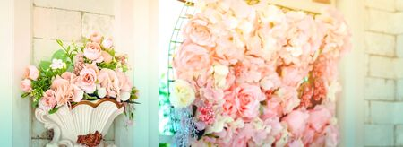 Many artificial pink and white roses are decorated on the wall to the backdrop in the wedding day. Beautiful flowers background, Selective focus. Imagens