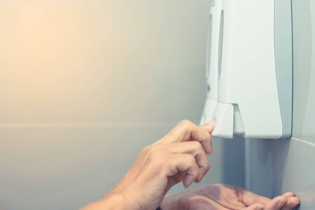 Close up to Hands of woman pumping soap with liquid soap press in the restroom for wash the hands. Cleaning and Healthcare Concept. Reklamní fotografie