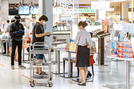 KANCHANABURI/THAILAND-APRIL 28,2020 : Atmosphere of ordering food to be taken back to eat at home in the situation of the spread of the corona virus (Covid-19) at Robinson Department Store.