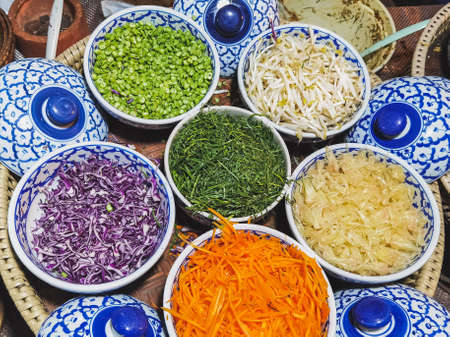 Close up to Vegetables and fruits and various food ingredients for cooking delicious Thai Southern Spicy Rice Salad with Vegetable. Thai cuisine, Popular Thai southern food. Selective focus. Standard-Bild