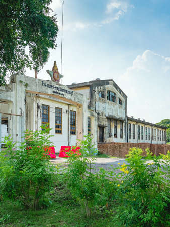 The old paper mill used to produce paper during World War II, transformed into a new public attraction and Thai characters at the entrance translate to English as Thai paper factory Kanchanaburi, 1938 Editorial