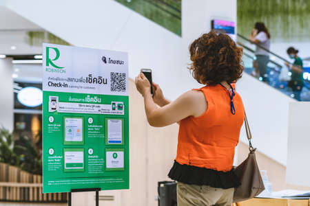 KANCHANABURI,THAILAND-JULY 11,2020: Unidentified customers need scan QR CODE to go to the Thai Chana website to check-in during the outbreak of Corona virus(Covid-19) at the entrance gate at Robinson.