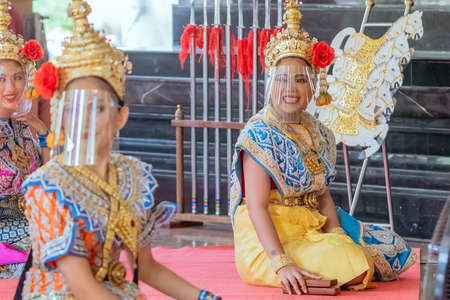 NAKHONPATHOM ,THAILAND-FEBRUARY 14,2021:Traditional Thai dance with protective face shield to prevent CoronaVirus(Covid-19) presented to spirit of PraRaaHoo to reward in return for giving him his wish