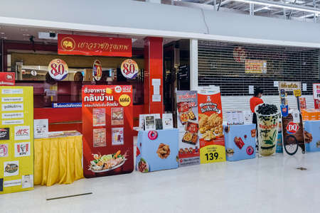 KANCHANABURI, THAILAND-AUGUST 21,2021 : Thai People order food by menu to take home inside of Tesco Lotus closed due to the corona virus (Covid-19) outbreak but opens only food section at Tesco Lotus.