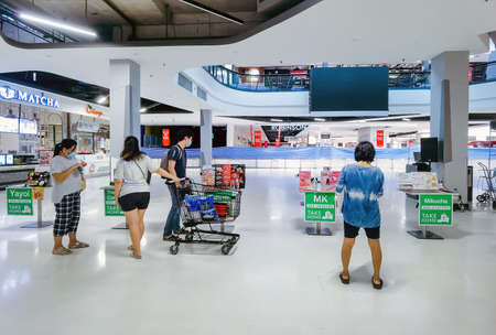 KANCHANABURI, THAILAND - AUGUST 21,2021 : Thai People order food by menu to take home inside of Robinson closed due to the corona virus (Covid-19) outbreak but opens only food section at Robinson.