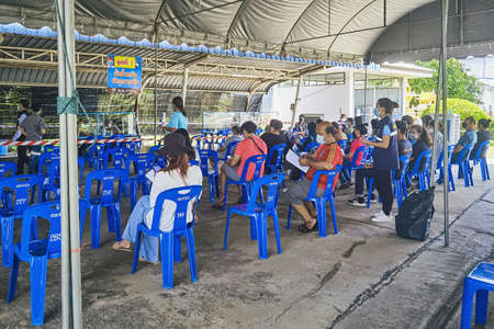 KANCHANABURI, THAILAND-AUGUST 25,2021 : Unidentified people wait in a queue to take first dose of the COVILO (Sinopharm) Coronavirus vaccine during Thailand's vaccination drive to all adults at local. Sajtókép