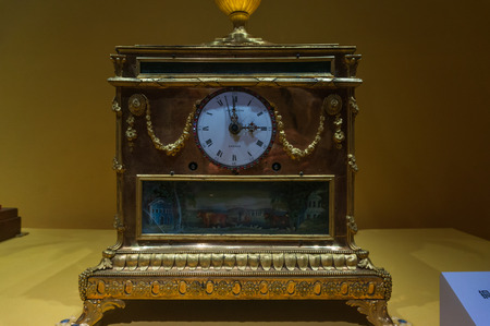 Xiamen, China - May 30, 2018: The Gold-Plated Brass Clock and Music Box with Moving Flower and Butterfly Decorations from 18th Century of Britain