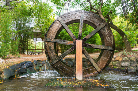 Wooden Wheel of Ancient Water Mill in Village