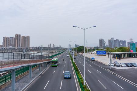 Xiamen, China - Apr 07, 2018: Timelapse, Car Traffic And  Subway At Seaside Near Xiamen Garden Expo Editorial