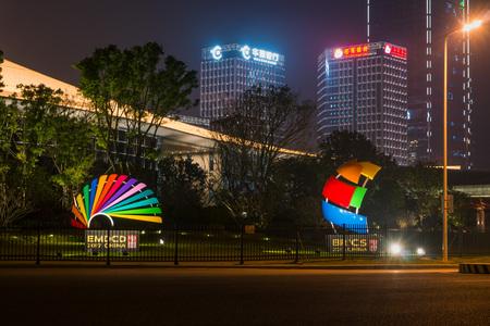 Xiamen, China - Apr 05, 2018: BRICS and EMDCD Sculpture with Modern Skyscraper Background