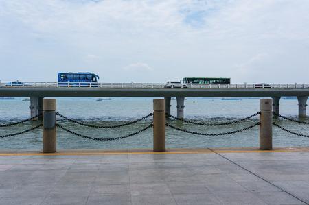 Car Traffic at Yanwu Bridge With Sea and Blue Sky, Xiamen, China