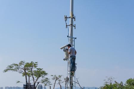Xiamen, China - May 31, 2018: Engineer repair Communication equipment at Gulangyu Island Editorial