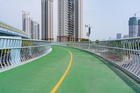 Xiamen, China - May 31, 2018: Green Air Bike Lane Upon Road