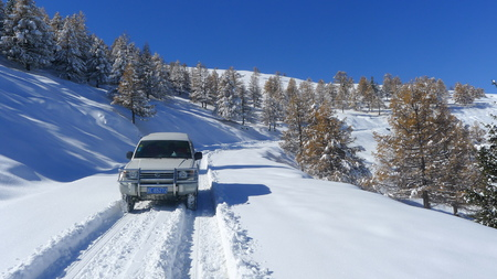 Sport utility vehicle on snowy mountain