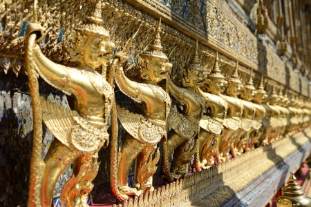 Golden Statues on the wall of the Emerald Temple in Bangkok in Thailand Stock Photo - 17472736