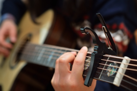 Electric Acoustic guitar neck with a capo