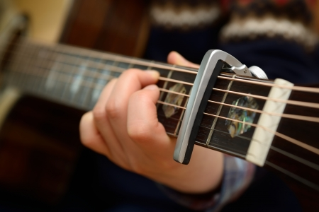 Electric Acoustic guitar neck with a capo Stock Photo - 17546458