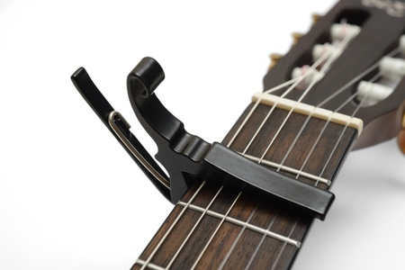 Electric Classic guitar neck with a capo Stock Photo - 17546459