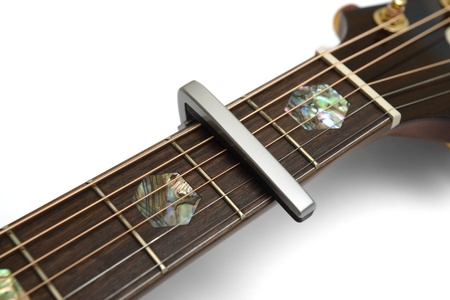 Electric Acoustic guitar neck with a capo Stock Photo - 17546464