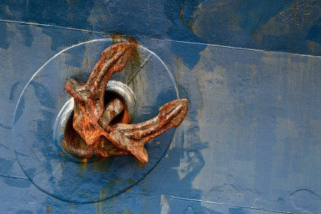 rust Anchor on a blue ship photo
