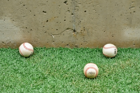 Three baseball ball on grass photo