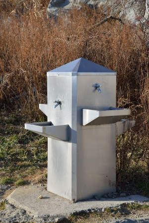 Steel Made Water Fountain in field photo
