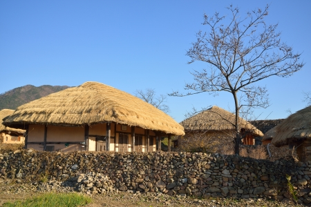 thatched roof house in Korean Traditional old town called NakAn in Korea photo