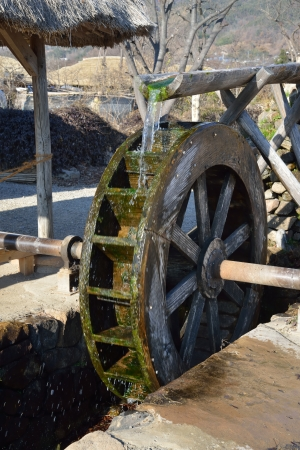 Korean Traditional waterwheel in NakAn Old Town Imagens - 24824933