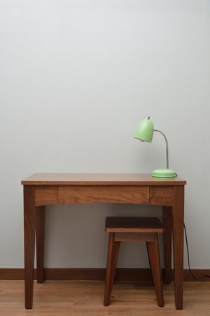 wooden Brown Table with a Lamp in bedroom photo