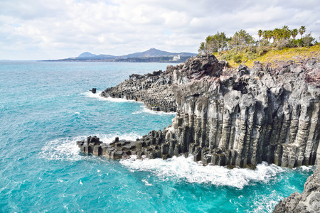 basaltic columnar joint coast in JungMun in Jeju Island photo