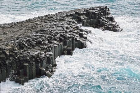 columnar: basaltic columnar joint coast in JungMun in Jeju Island