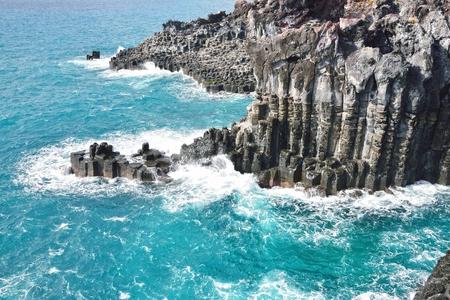 basaltic columnar joint coast in JungMun in Jeju Island photo