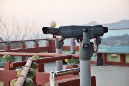 tourist binoculars at octagonal pavilion of Bugak Skyway in Seoul, Korea photo