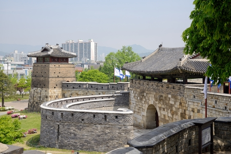 the world cultural heritage: Hwaseomun is the west gate to Hwaseong. Its stone base is capped with a one-storey wooden pavilion.