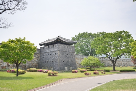 gabled: Bukseo-GunTower is adjacent to Bukseo Jeokdae. Made from black bricks, it is divided into three storeys internally by boards. Firearms were secreted on these floors. The roof is unusual in design, being gabled on the inner side (towards the wall) and angl