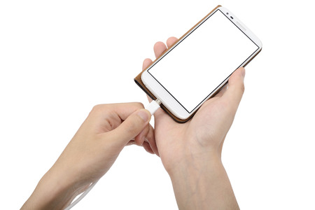 smart phone in case and charging cable on a hand photo