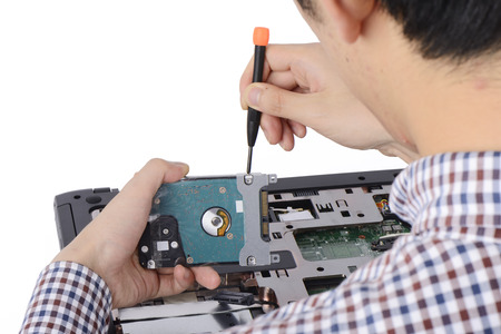 replacing a laptop hard disk drive on a white background photo